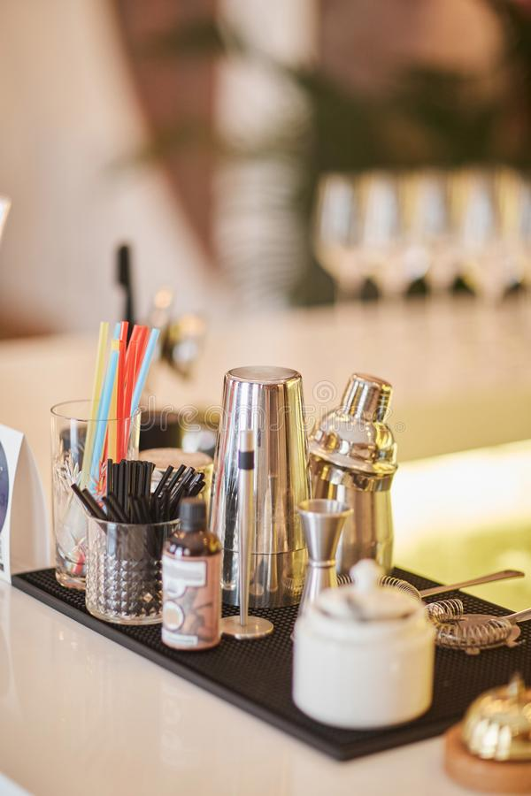 Set of equipment for the bartender, mixing glass, cocktail shaker, bar. stock image