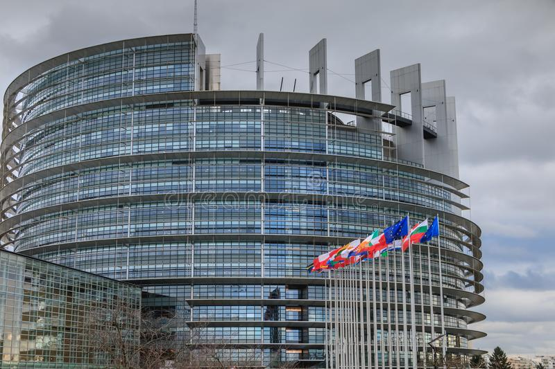 Set of European flags in front of the European Parliament stock image