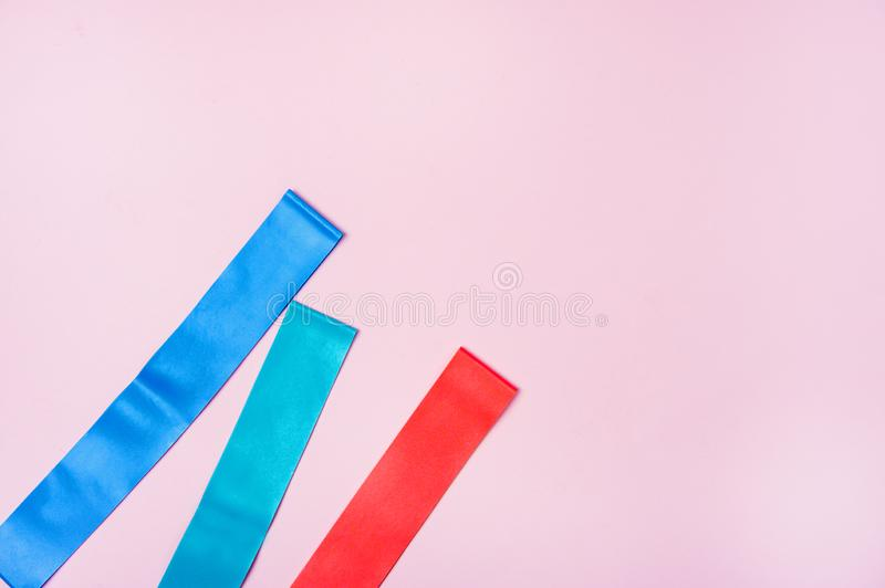 Set of Exercise Bands for Fitness on Pink Background Weight Loss Concept Top View Flat Lay Horizontal royalty free stock images