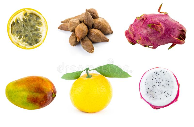 Set of exotic fruits manga dragon fruit tangerine with green leaves ptokhaya and half of yellow passion fruit royalty free stock photo