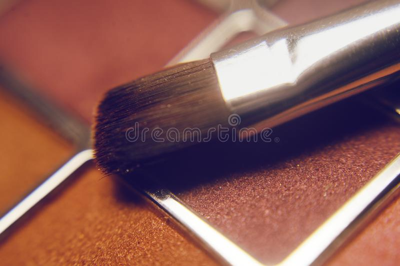 Set of eye shadows . Make up products . Makeup brushes and colorful, bright palette of shadows. stock photos