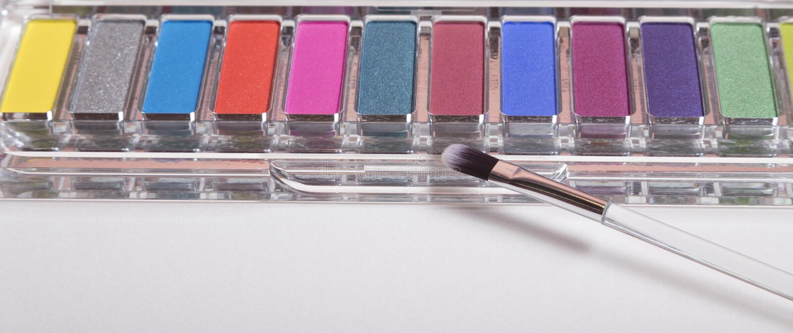 Set of eyeshadow and applicator isolated. On white royalty free stock image