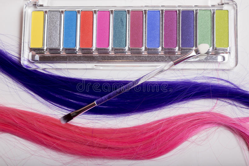 Set of eyeshadow, applicator and strands of hair. Isolated on white stock image