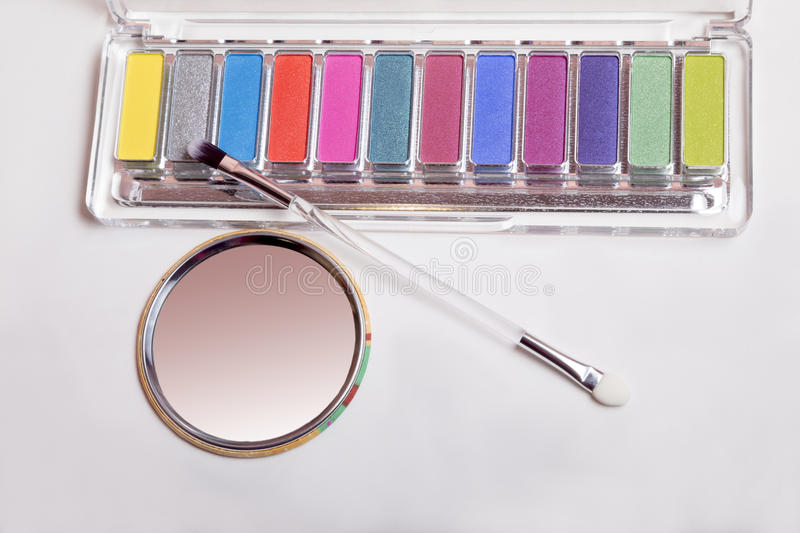 Set of eyeshadow, mirror and applicator. Isolated on white stock images