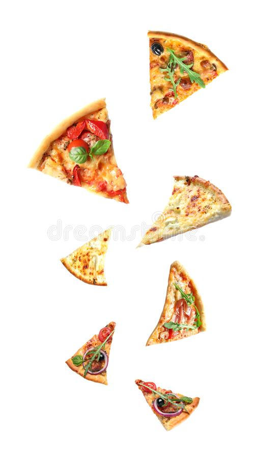 Set with falling different pizza slices royalty free stock photos