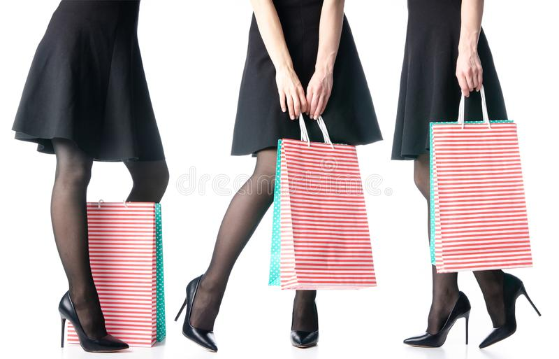 Set female legs in black high heels shoes bags package black skirt fashion. On white background isolation stock images