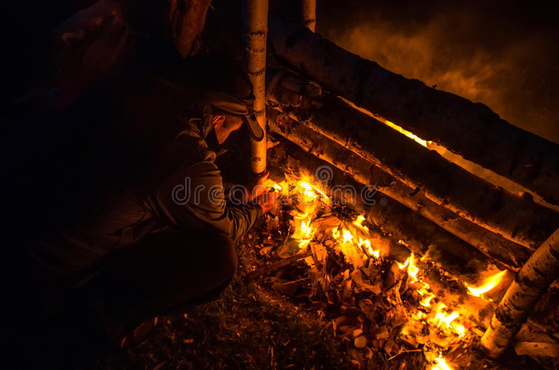 Set Fire. Camping. A man arsons wood stock photos