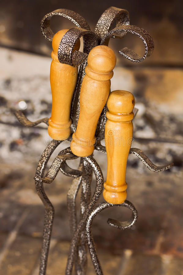 Set of fireplace accessories is on the background of fireplace royalty free stock image