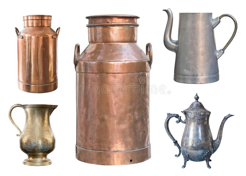 Set of five vintage containers. Brass milk cans, aluminum and metal kettles and a copper jug royalty free stock photo