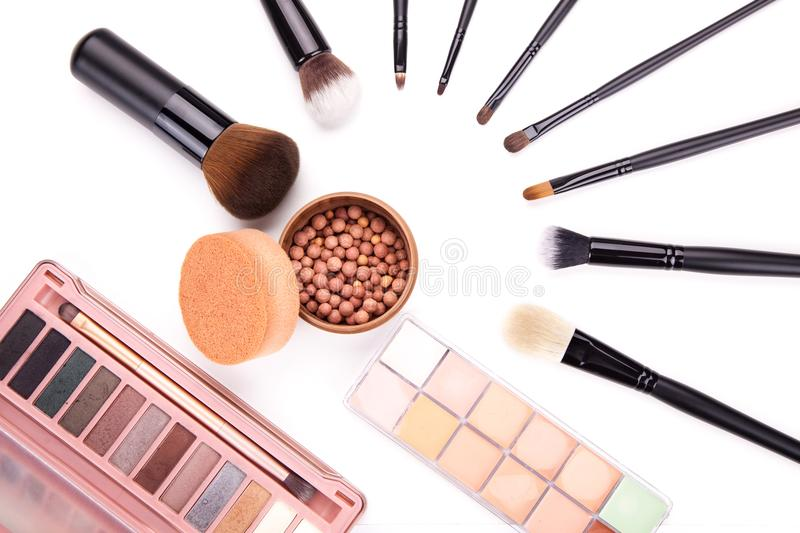 Set of flat top view of various professional female cosmetics brushes for makeup and eyelash brush on black background, C. Osmetics concept, Make up concept royalty free stock image