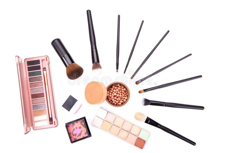 Set of flat top view of various professional female cosmetics brushes for makeup and eyelash brush isolated on black background, C. Osmetics concept, Make up royalty free stock photos