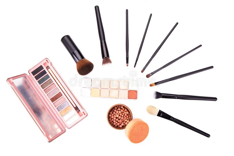 Set of flat top view of various professional female cosmetics brushes for makeup and eyelash brush isolated on black background, C. Osmetics concept, Make up royalty free stock images