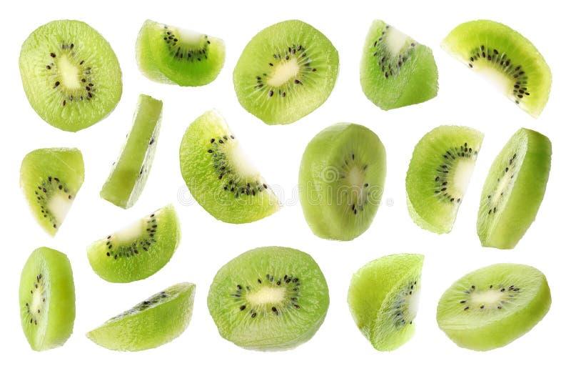 Set of flying cut fresh juicy kiwi on white royalty free stock photography