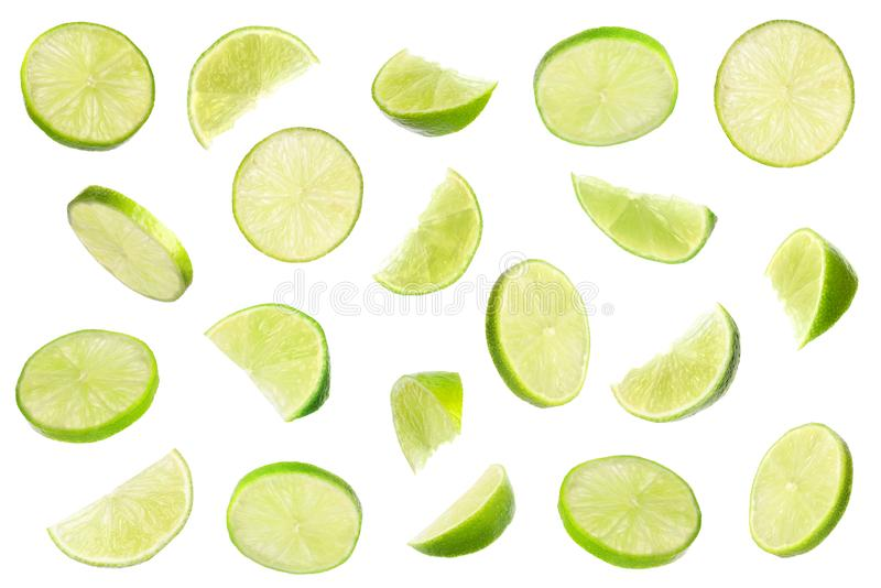Set of flying cut fresh juicy lime on white. Background royalty free stock photos