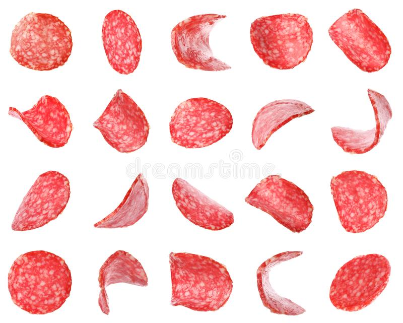 Set of flying cut fresh sausage on white royalty free stock images