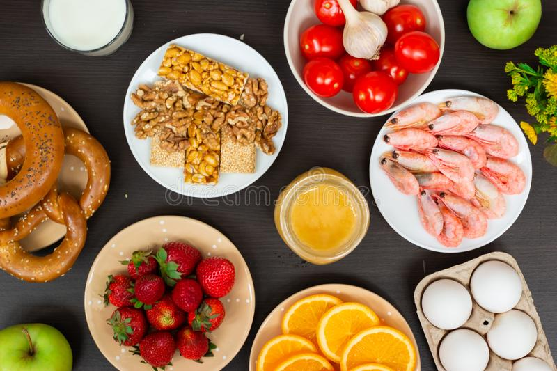 Set of food that cause allergy. Top view. Set of food that cause allergy on wooden table royalty free stock images
