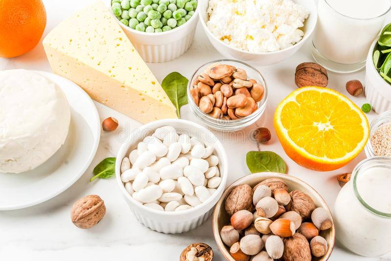 Set of food rich in calcium. Healthy food concept. Set of food rich in calcium - dairy and vegan Ca products, white marble background top view royalty free stock image
