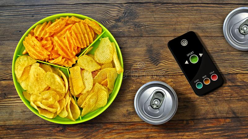 Set of football fan - chips - special remote control and drink stock photo