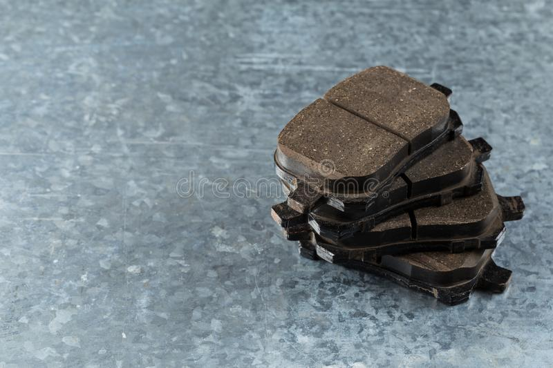 Brake pads on a gray background royalty free stock image