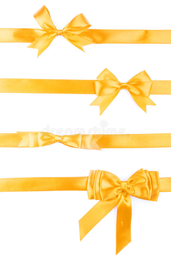Set of four golden ribbon gift bow stock images