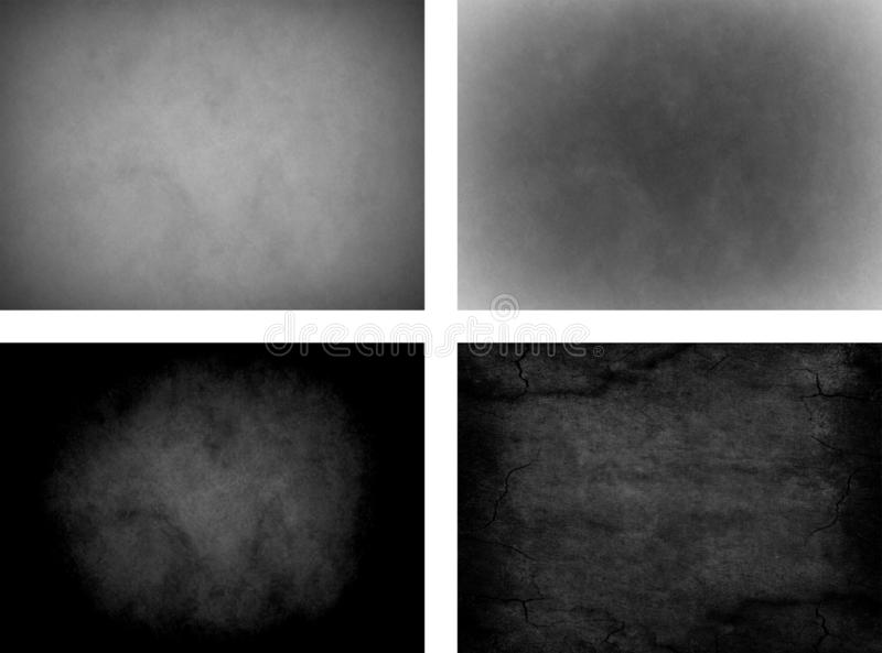 Set of four grunge overlay textures. royalty free stock image
