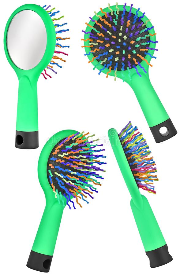 Set of four instances of a green hair comb brush for children, with handle and mirror on the back, isolated on transparent or. White background royalty free stock photos
