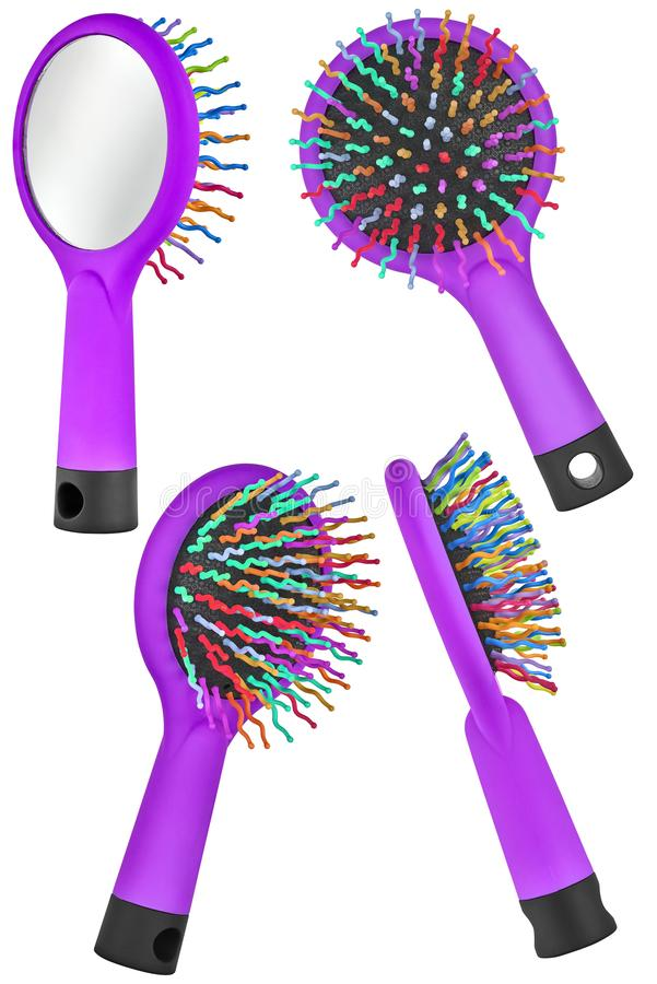 Set of four instances of a purple hair comb brush for children, with handle and mirror on the back, isolated on transparent or. White background royalty free stock images