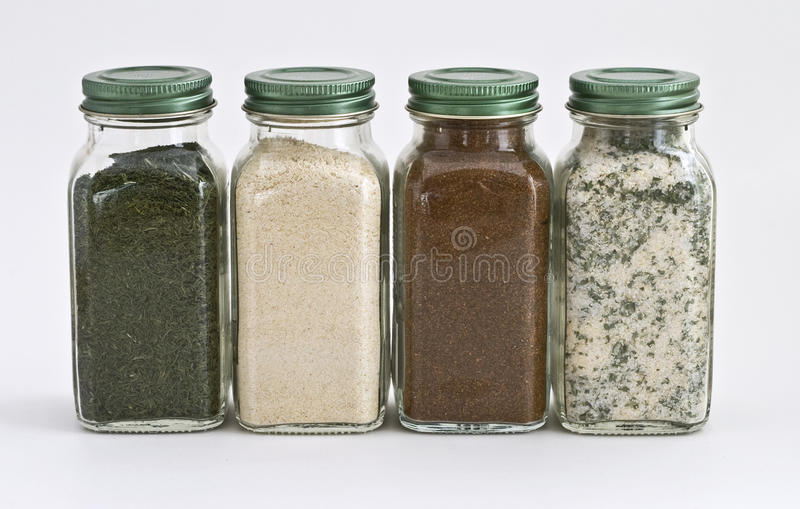 Download Set Of Four Spices In Glass Jars Stock Photo - Image: 19034696