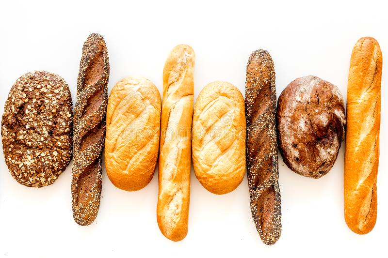 Set of fresh homemade bread. Bread assortment. Loaf, baguette. White and brown bread on white background top view stock photography