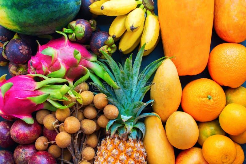 Set fresh organic exotic tropical fruit on dark stock photo