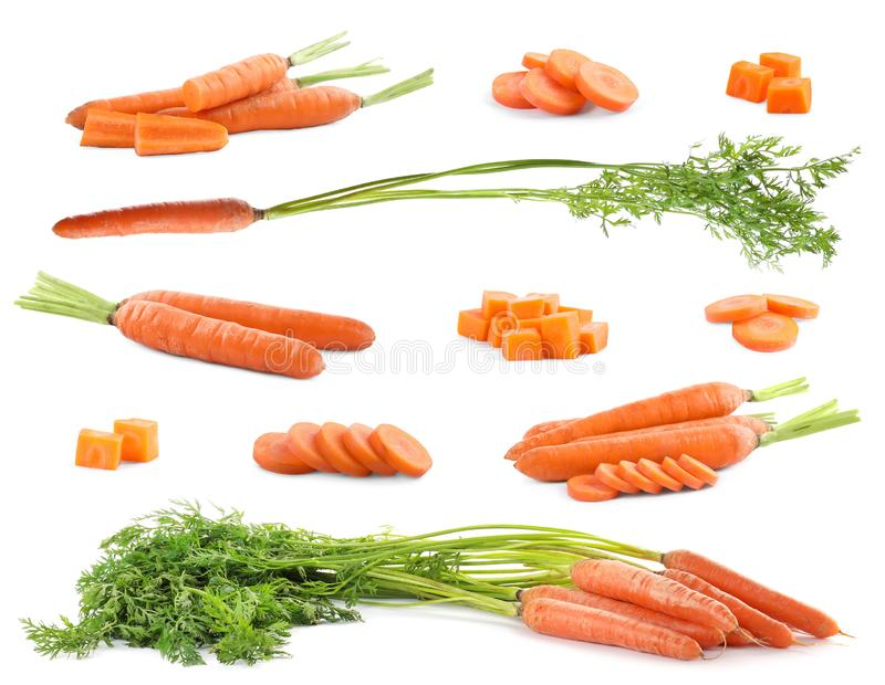 Set of fresh ripe carrots on white stock image