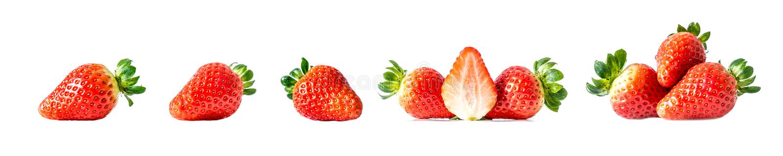 Set of fresh ripe red strawberries with green leaves close-up, isolated on a white background. A large size photo of a collection stock photography