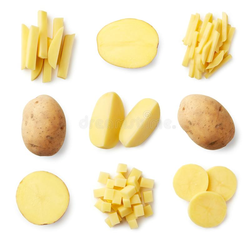 Set of fresh whole and sliced potatoes. Isolated on white background. Top view stock image