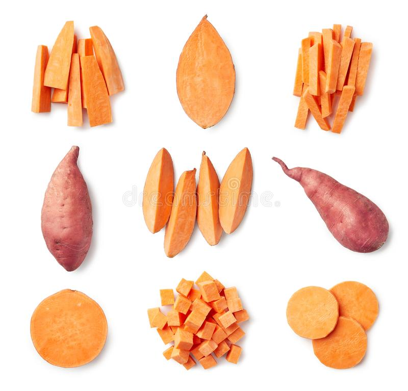 Set of fresh whole and sliced sweet potatoes. Isolated on white background. Top view stock photography