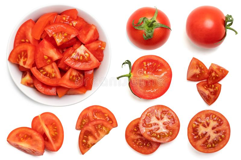 Set of fresh whole and sliced tomatoes isolated on white background. Top view stock photography