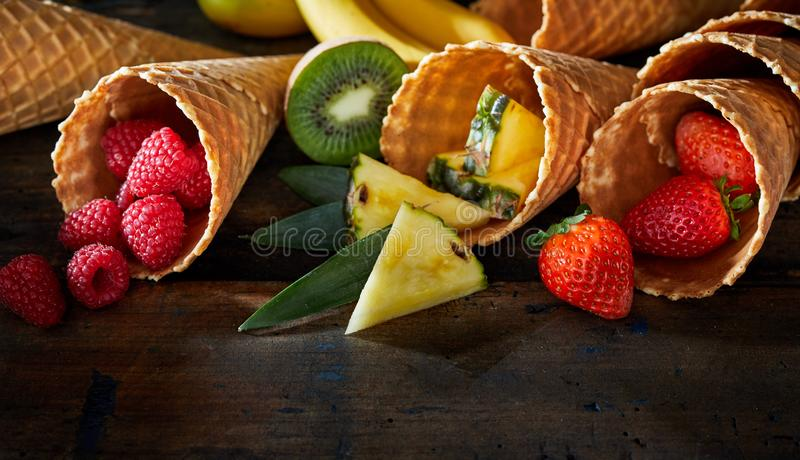 Set of fruit desserts in waffle cones stock image