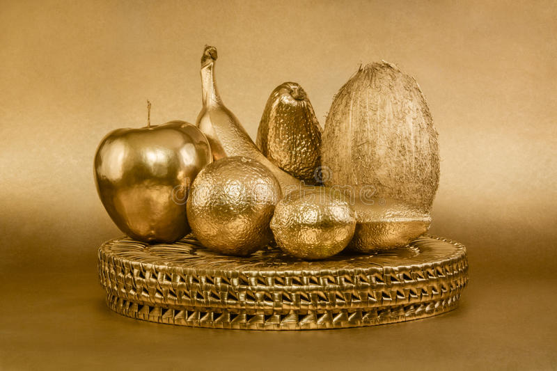 Set of fruits with golden peel on gold background. Set of golden fruits on gold background stock image