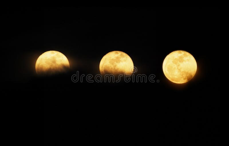 Set of full moon over dark night sky royalty free stock image