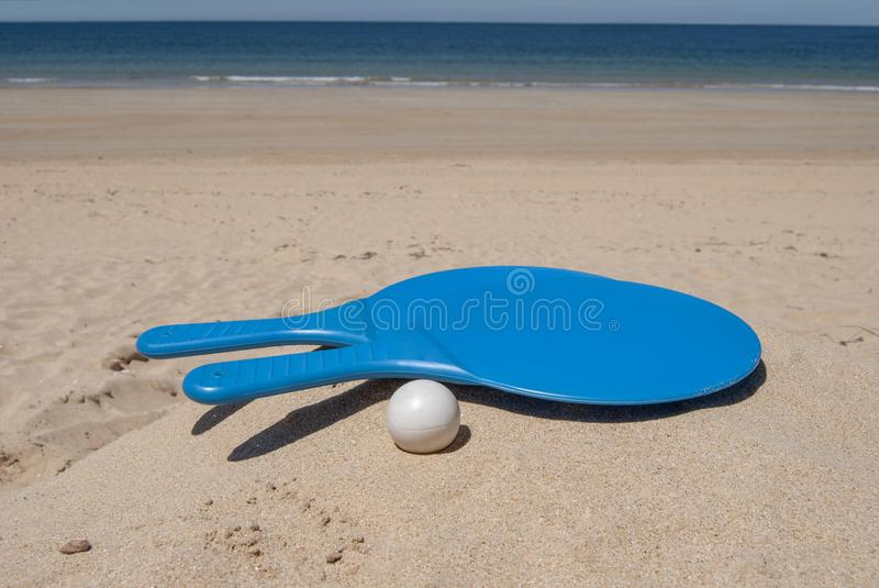 Set for a game of beach tennis isolated on the background sand royalty free stock images