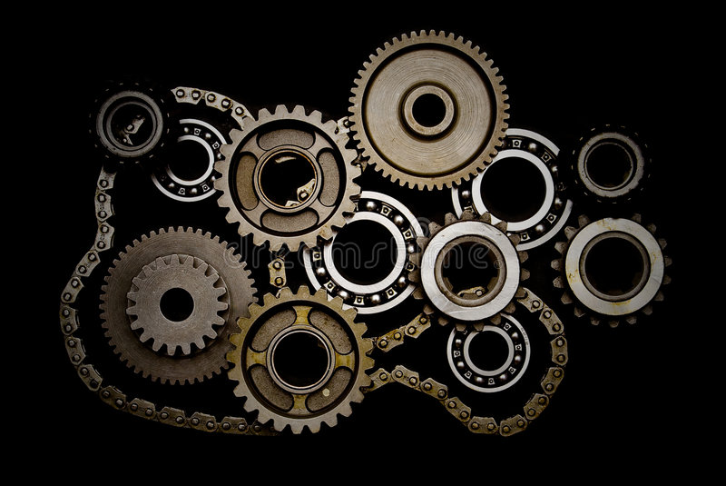 Set of gears, ball-bearings and chain. Isolated on black background stock photo