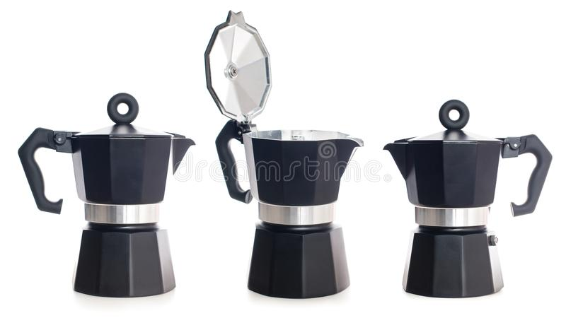 Set of geyser coffee maker. Nice design of the set of black geyser coffee maker ital. la moka on the table, isolated on white background royalty free stock photography