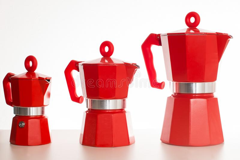 Set of geyser coffee maker. Nice design of the set of red geyser coffee maker ital. la moka on the table stock images