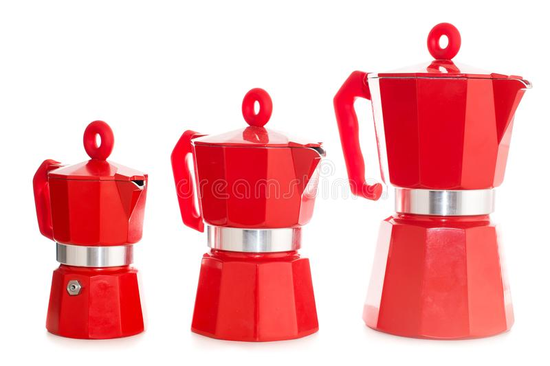 Set of geyser coffee maker. Nice design of the set of red geyser coffee maker ital. la moka on the table isolated on white background stock photography
