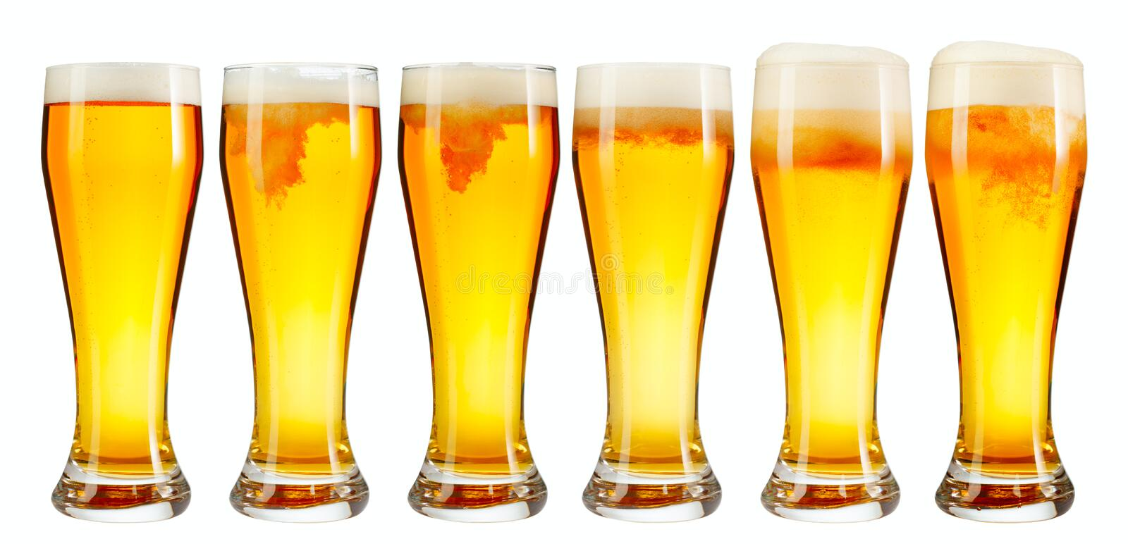 Set of a glass of cold light beer with foam isolated on white background. Set of a glass of cold light beer with foam isolated on white background stock images