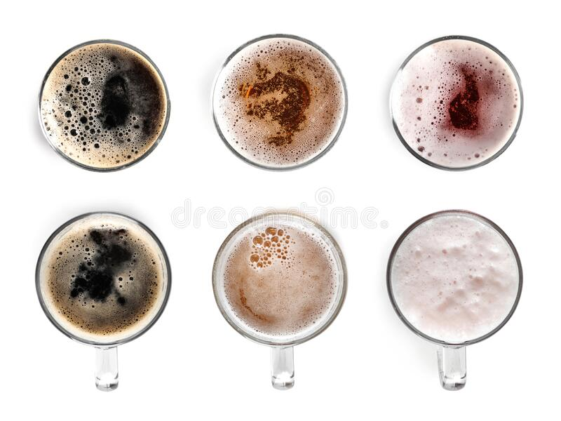 Set with glasses of cold tasty beer on background, top view royalty free stock photos