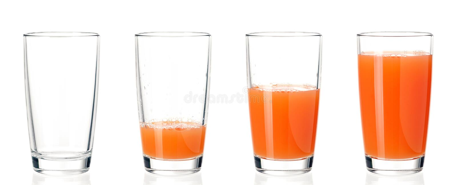 Set of glasses juice. Set of four glasses with fresh grapefruit juice, isolated on white background. Studio shot royalty free stock images