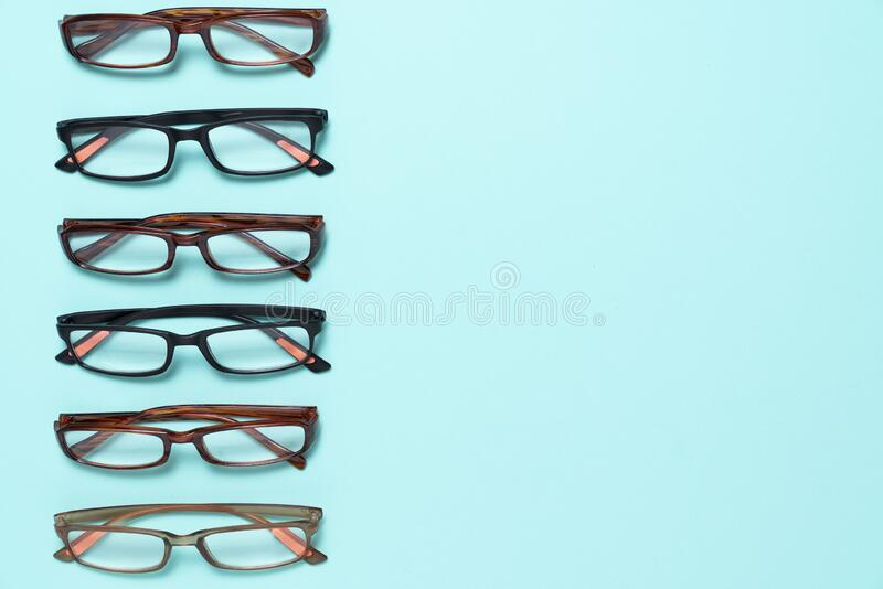 A set of glasses model on the green table background stock images