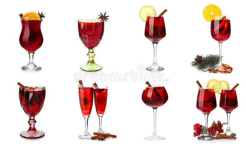 Set of glasses with tasty mulled wine on white background royalty free stock photography