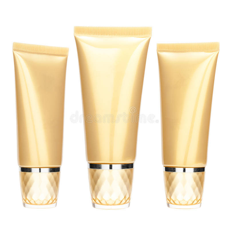 Set of gold cosmetic tube royalty free stock images