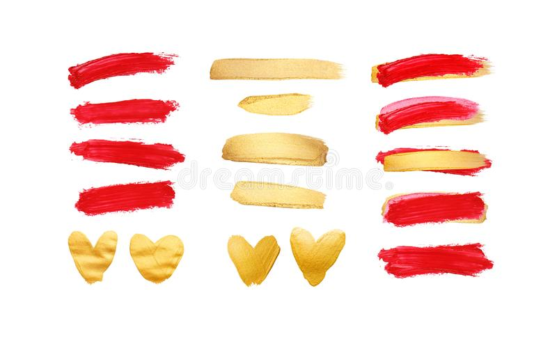 Set of gold and red strokes isolated on white background. Lipstick bullet smudged. Beautiful textured brush strokes and stock image